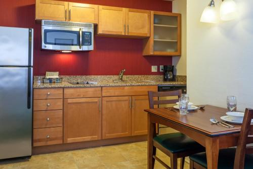 A kitchen or kitchenette at Residence Inn South Bend