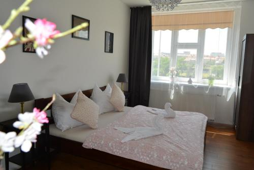 Postel nebo postele na pokoji v ubytování MM Apartments 10 min from center