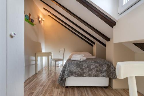 Postelja oz. postelje v sobi nastanitve Casa Carminatti Apartments
