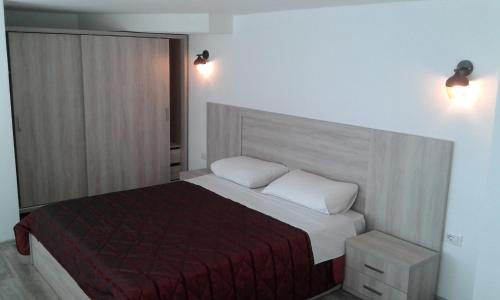 A bed or beds in a room at Apartments Globus