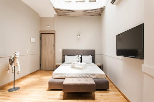 A bed or beds in a room at Step One | Luxury Suites right in the heart of Acropolis next to metro station