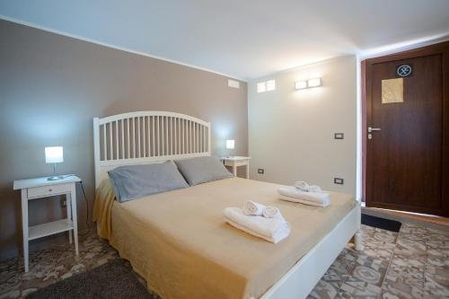 A bed or beds in a room at A Corte