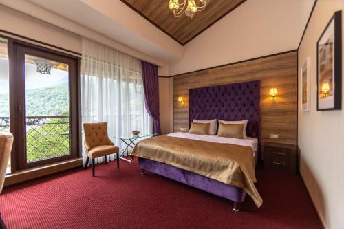 Кровать или кровати в номере VERTEX SPA hotel