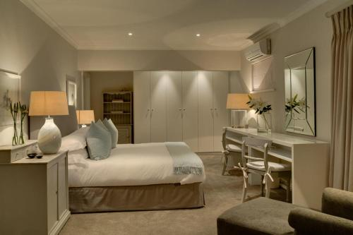 A bed or beds in a room at Cape View Clifton