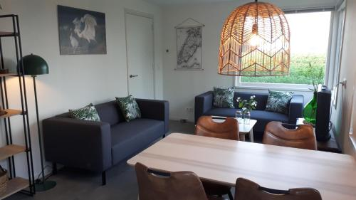 A seating area at Bungalow Groen