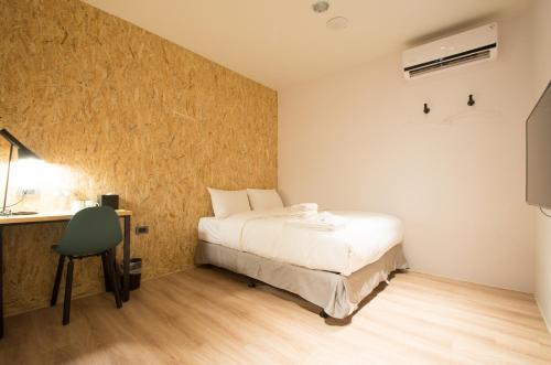 承億輕旅高雄館房間的床