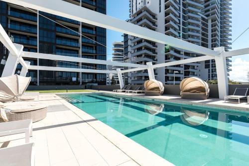 The swimming pool at or near Broadbeach 2 Bedroom FREE WIFI, Netflix & Parking