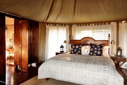 Postel nebo postele na pokoji v ubytování Thanda Safari