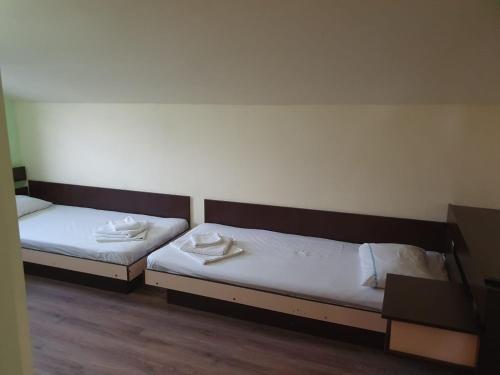 Un pat sau paturi într-o cameră la Vila Gugi