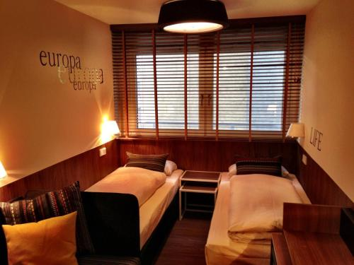 A bed or beds in a room at Hotel Europa Life