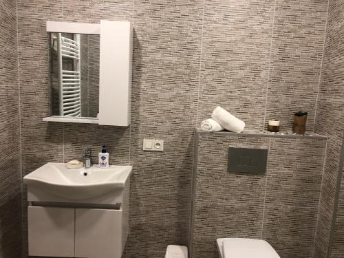 A bathroom at Modern Apartment