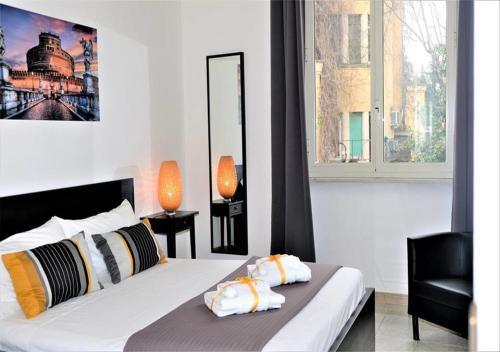 Letto o letti in una camera di Colle Aventino Home