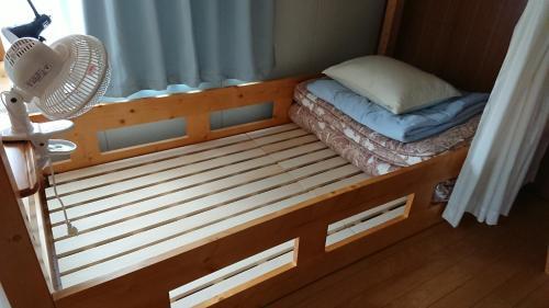 ゲストハウス みんなのいえにあるベッド