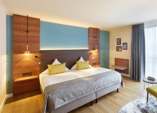 A bed or beds in a room at Aquis Grana City Hotel