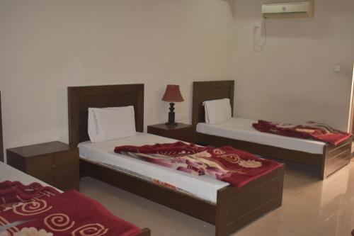 A bed or beds in a room at The Hotel