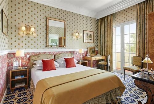 Un ou plusieurs lits dans un hébergement de l'établissement Hôtel Belles Rives