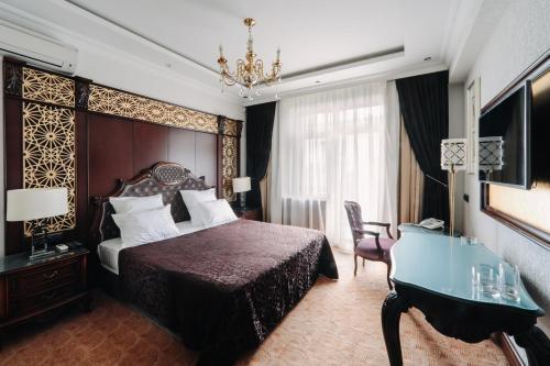 Кровать или кровати в номере Fidan Spa Hotel Sochi