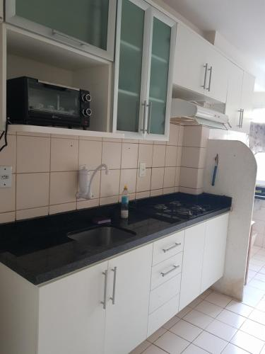 A kitchen or kitchenette at Apartamento Aju