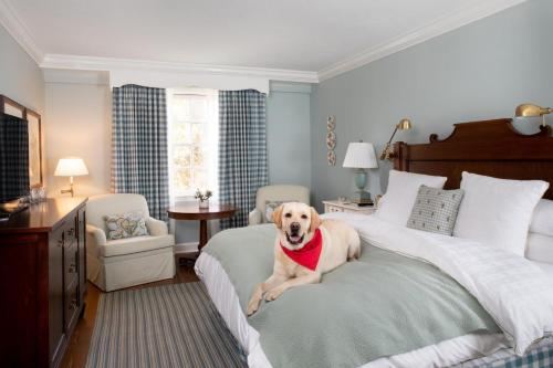 A bed or beds in a room at Woodstock Inn & Resort