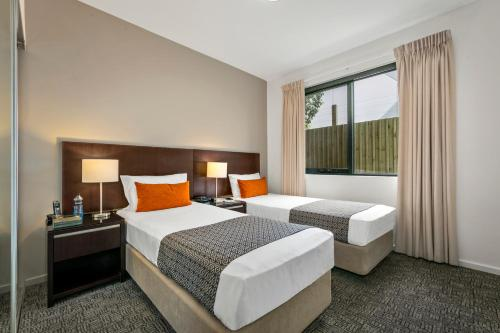 A bed or beds in a room at Quest Moorabbin