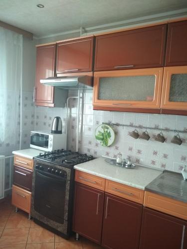 Кухня или мини-кухня в Apartment in Vileyka