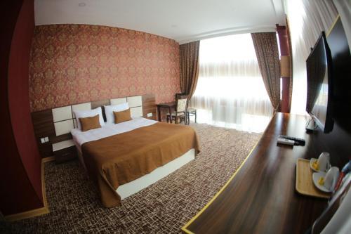 Cama ou camas em um quarto em Sea Park Hotel