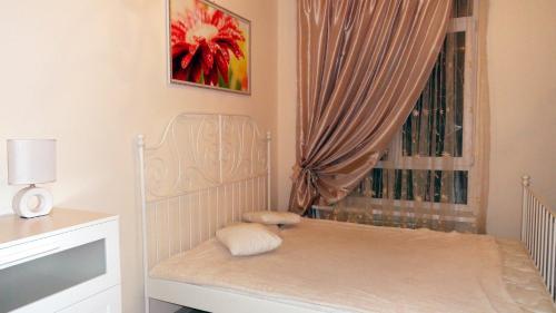 Кровать или кровати в номере 1 Bedroom Apartment on Uchitelskaya