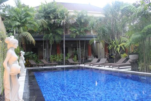 The swimming pool at or near Puri Anom Guest House