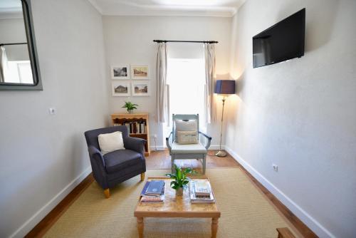 Uma área de estar em Casa Augustus