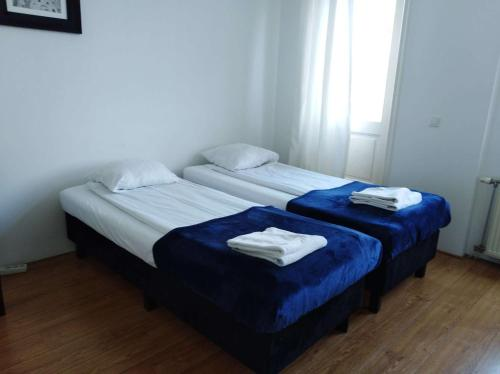 A bed or beds in a room at Bnbmoon