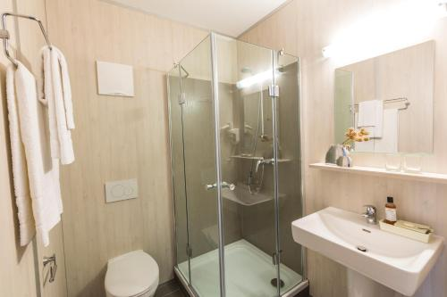 Ein Badezimmer in der Unterkunft Topmotel