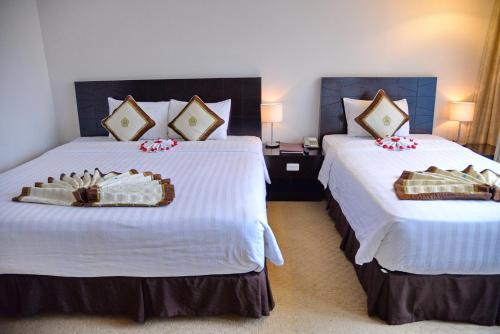 Giường trong phòng chung tại Sai Gon Ban Me Hotel