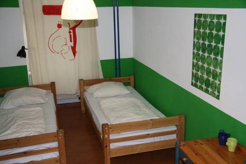 Кровать или кровати в номере Lette'm Sleep Berlin