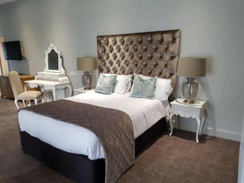 A bed or beds in a room at Great Hallingbury Manor