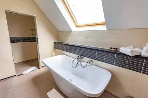 A bathroom at Great Hallingbury Manor