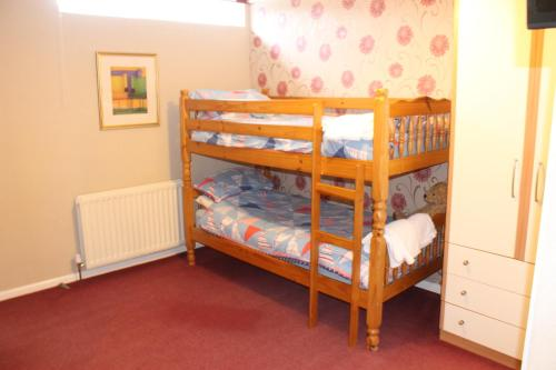 A bunk bed or bunk beds in a room at The Fernside