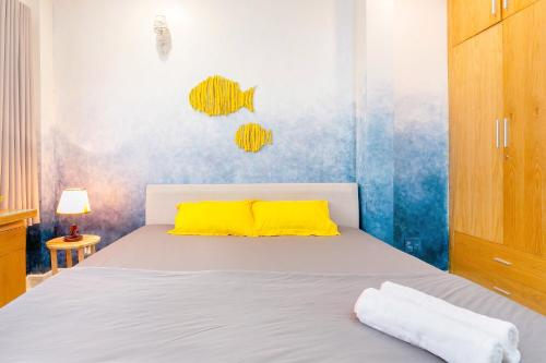 A bed or beds in a room at Qcub1 Homestay