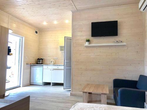 Телевизор и/или развлекательный центр в Гостевой дом Биг Фиш