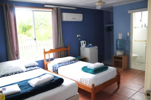 A bed or beds in a room at Great Keppel Island Hideaway
