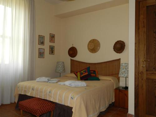 A bed or beds in a room at B&B Le Tre Civette