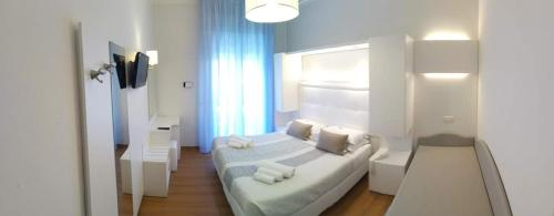 A bed or beds in a room at Albergo Vittoria