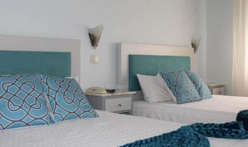 A bed or beds in a room at Classico