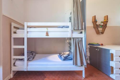 A bunk bed or bunk beds in a room at La Maïoun Guesthouse