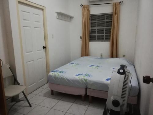 Cama ou camas em um quarto em Roxsha Apartments