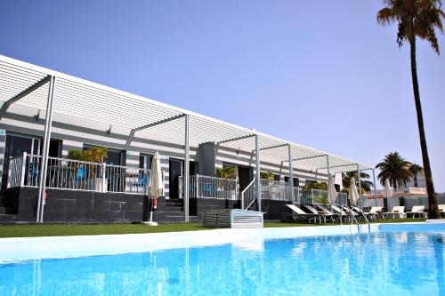 The swimming pool at or near Tajinaste Beach Gay Men Only