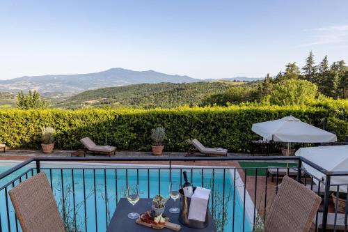 Вид на бассейн в Si Montalcino Hotel & Restaurant или окрестностях