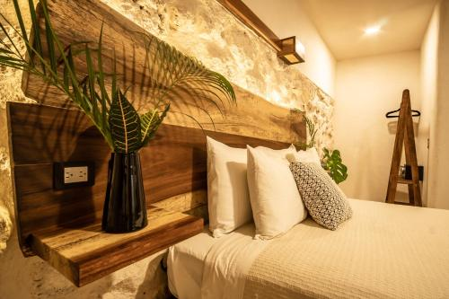 A bed or beds in a room at Hotel Boutique TerraNova