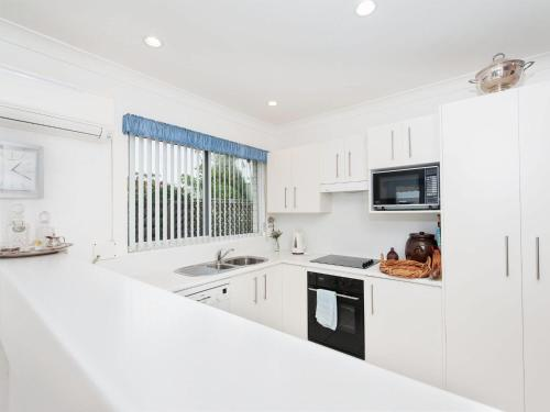 A kitchen or kitchenette at Grand View @ Nelson Bay