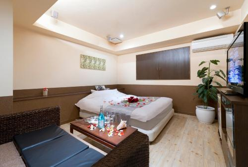 A bed or beds in a room at Hotel Monica Hayama (Adult Only)