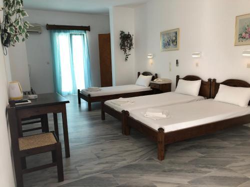 Ένα ή περισσότερα κρεβάτια σε δωμάτιο στο Malamas Apartments